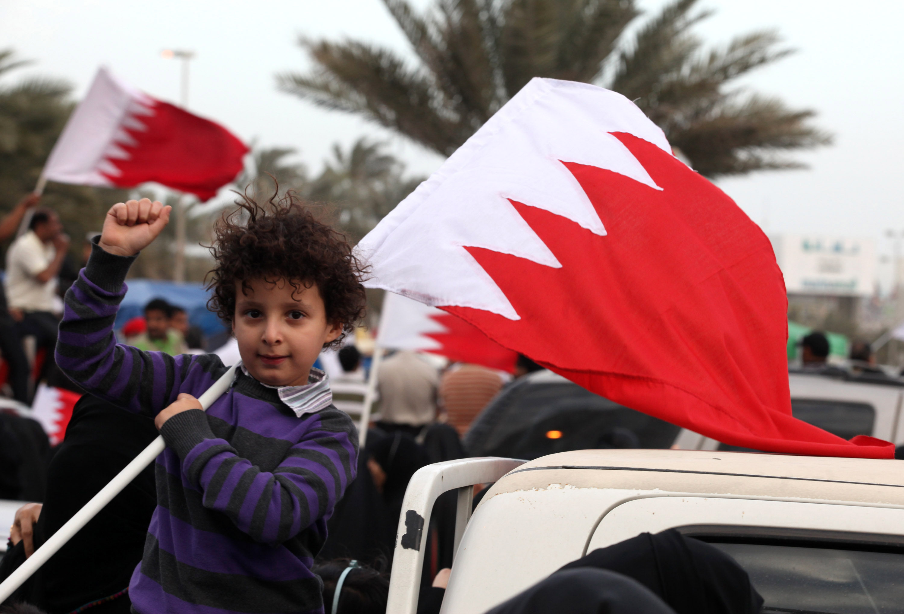 Bahraini predominantly Shiite protesters wave their national flag as they take part in an anti-regime rally at Pearl Square, the focal point of demonstrations for over two weeks, in Manama, Bahrain on March 1, 2011.  UPI/ Isa Ebrahim