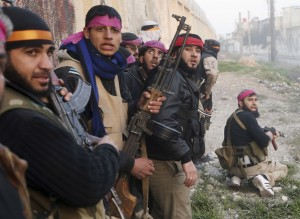 Syrian rebels prepare for an attack on a Syrian Army base in Damascus
