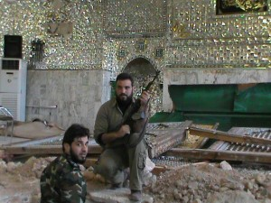 Member of al-Nusra front Pose at the desecrated grave site of Hujr ibn Adi