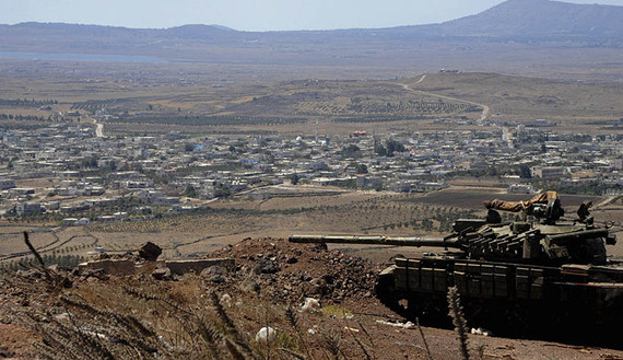 A tank belonging to forces loyal to Syria's President Assad is seen in the Quneitra city countryside during a battle with rebels