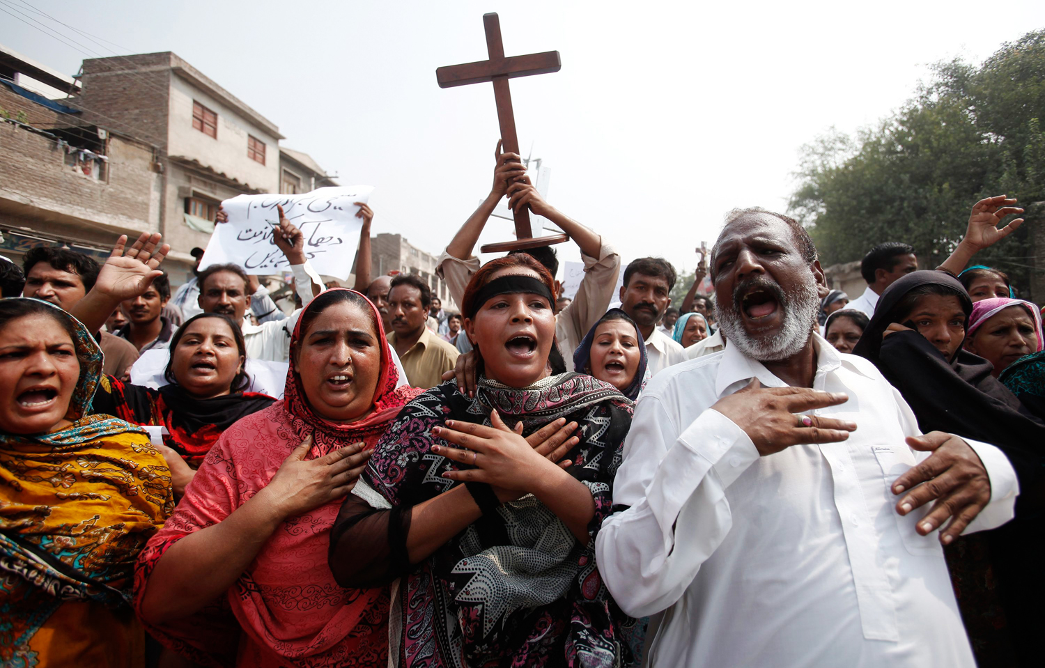 Members of the Pakistani Christian community chant slogans during a protest rally to condemn Sunday's suicide attack on a church service in Peshawar.