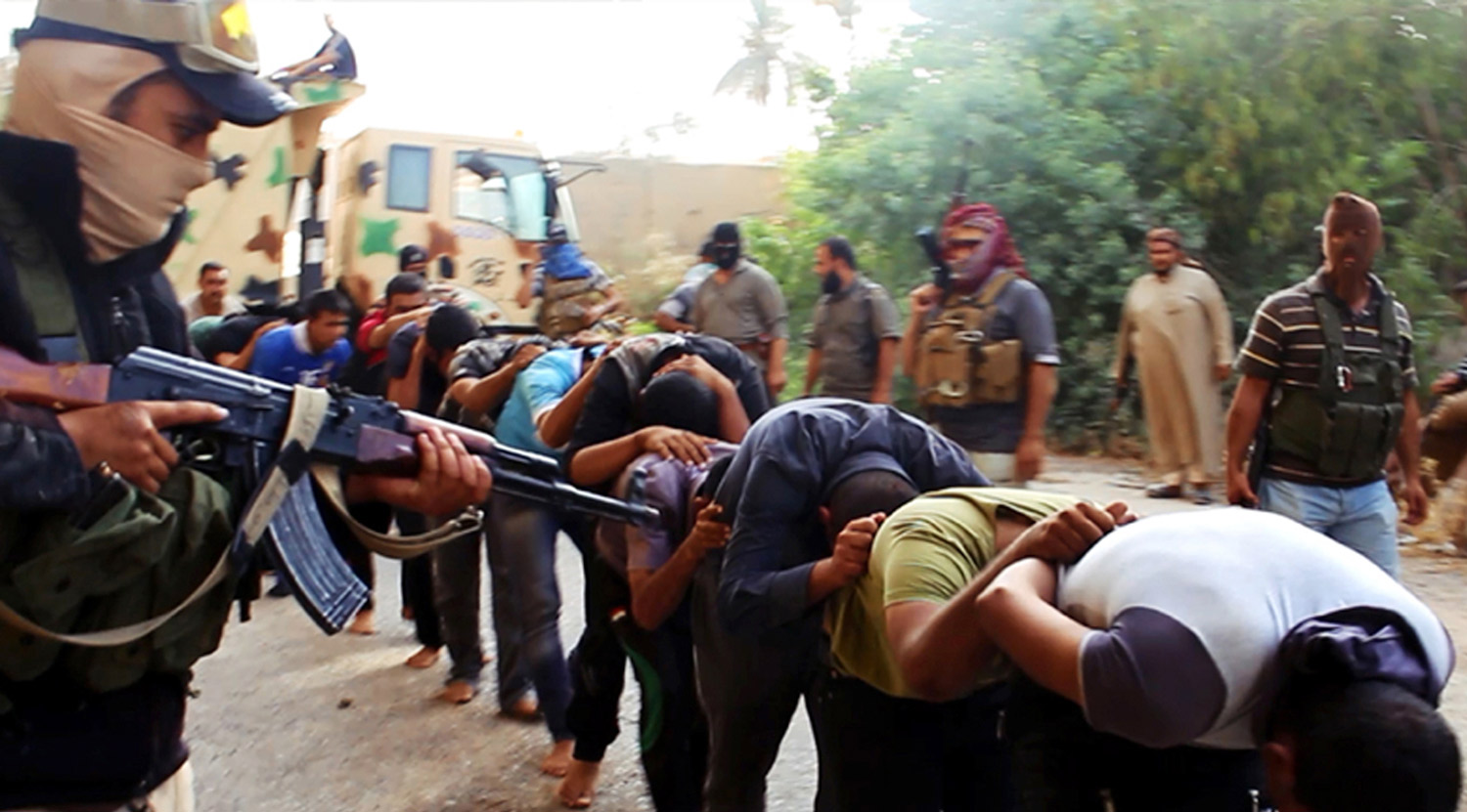 An image posted by militants from the Islamic State of Iraq and al-Sham (ISIS) shows insurgents leading away captured Iraqi soldiers, who were later massacred.